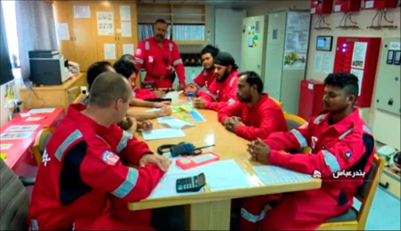 """An image grab taken from a broadcast by Islamic Republic of Iran Broadcasting (IRIB) on July 22, 2019 shows crew members of the British-flagged tanker Stena Impero, after it was seized by Iran's Revolutionary Guard Corps. Britain on July 23, said it was planning a European-led protection force for shipping in the Gulf after Iranian authorities seized a British-flagged tanker in a dramatic escalation of tensions in the region. In a ramping up of tensions, the Islamic Revolutionary Guard Corps seized the Stena Impero on July 19 in the Gulf's strategic Strait of Hormuz. / AFP / IRIB / - / RESTRICTED TO EDITORIAL USE - MANDATORY CREDIT """"AFP PHOTO / HO / IRIB"""" - NO MARKETING NO ADVERTISING CAMPAIGNS - DISTRIBUTED AS A SERVICE TO CLIENTS  / NO RESALE - NO BBC PERSIAN / NO VOA PERSIAN / NO MANOTO TV"""