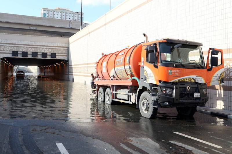 Municipal workers attempt to clear a flooded tunnel in Sharjah on Sunday morning. Courtesy: Sharjah Municipality