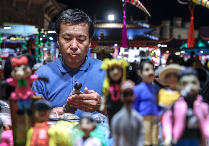 Abu Dhabi, United Arab Emirates, January 5, 2020.  Photo essay of Global Village.--  China Pavillion clay figurine artist, Du Junbaa, 65, China.  Has been in this stall for a year now.Victor Besa / The NationalSection:  WKReporter:  Katy Gillett