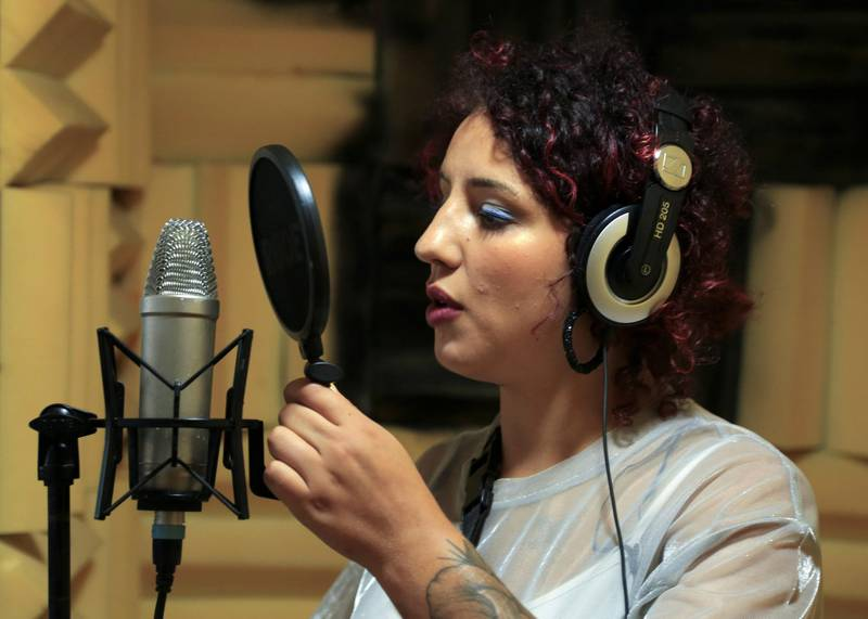 """Moroccan rapper Houda Abouz, 24, known by her stage name """"Khtek"""", records a song inside a studio in Rabat, Morocco July 20, 2020. Picture taken July 20, 2020. REUTERS/Shereen Talaat"""