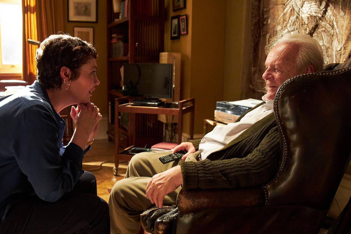 """This image released by Sony Pictures Classics shows Olivia Colman, left, and Anthony Hopkins in a scene from """"The Father."""" On Wednesday, Feb. 3, 2021 the film was nominated for a Golden Globe for best motion picture drama. (Sean Gleason/Sony Pictures Classics via AP)"""