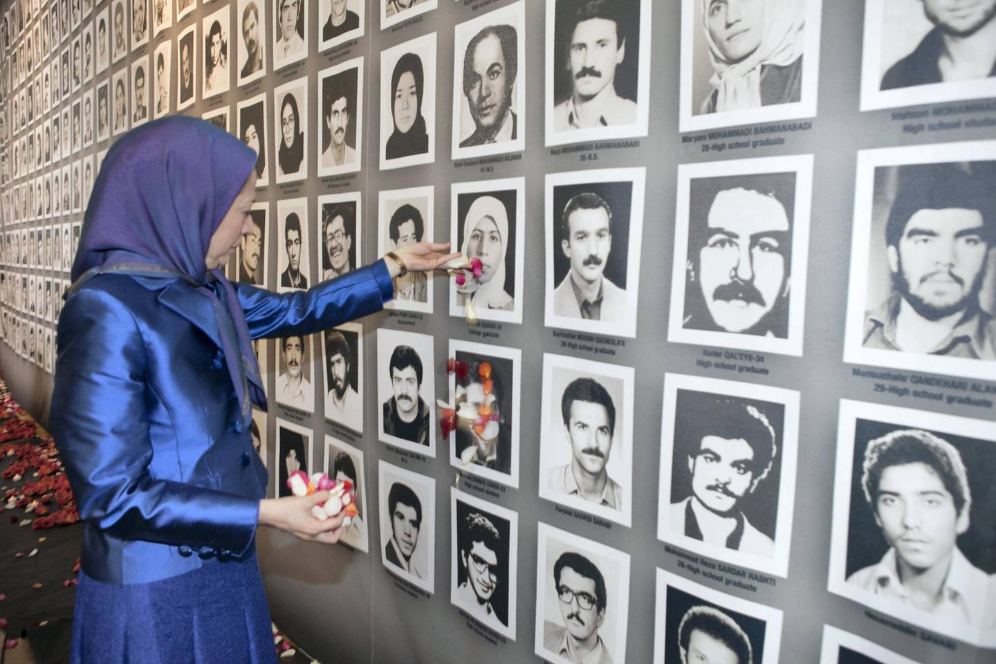 Maryam Rajavi, president-elect of the National Council of Resistance of Iran (NCRI) has called upon the U.N. to bring to justice those responsible for the massacre of 30,000 political prisoners in Iran during a visit to an exposition in Paris about these events. Jacques Boutaut, mayor of Paris' 2nd district, was also in attendance.  (Photo by Siavosh Hosseini/NurPhoto via Getty Images)
