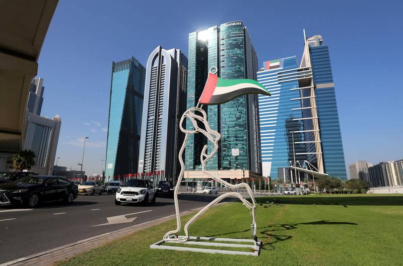Dubai, United Arab Emirates - November 30, 2020: National Day. Lights are set up on a roundabout the day before National Day. Monday, November 30th, 2020 in Dubai. Chris Whiteoak / The National