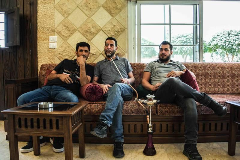 Baalbek, Lebanon, 10 October 2020. Members of the Jaafar family smoke shisha at the home of a relative. Elizabeth Fitt for The National