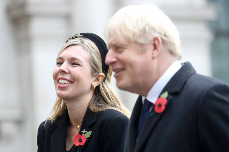 LONDON, ENGLAND - NOVEMBER 08: Britain's Prime Minister Boris Johnson with partner Carrie Symonds, meet veterans during the National Service of Remembrance at The Cenotaph on November 08, 2020 in London, England. Remembrance Sunday services are still able to go ahead despite the covid-19 measures in place across the various nations of the UK. Each country has issued guidelines to ensure the safety of those taking part. (Photo by Chris Jackson - WPA Pool/Getty Images)