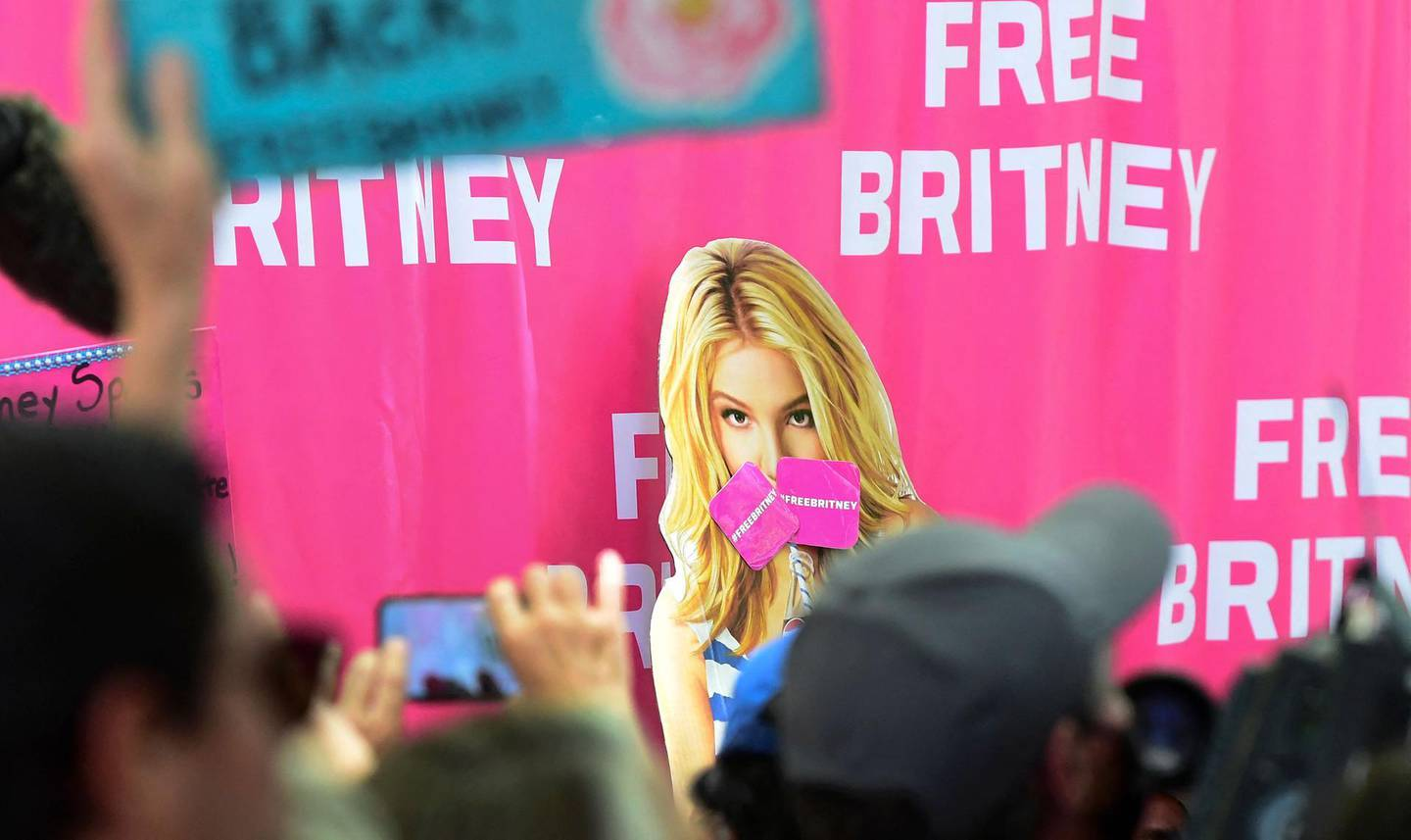"""Fans and supporters of Britney Spears gather outside the County Courthouse in Los Angeles, California on June 23, 2021, during a scheduled hearing in Britney Spears' conservatorship case.  Pop singer Britney Spears urged a US judge on June 23, to end a controversial guardianship that has given her father control over her affairs since 2008. """"I just want my life back. It's been 13 years and it's enough,"""" she told a court hearing in Los Angeles during an emotional 20-minute address via videolink.  / AFP / Frederic J. BROWN"""
