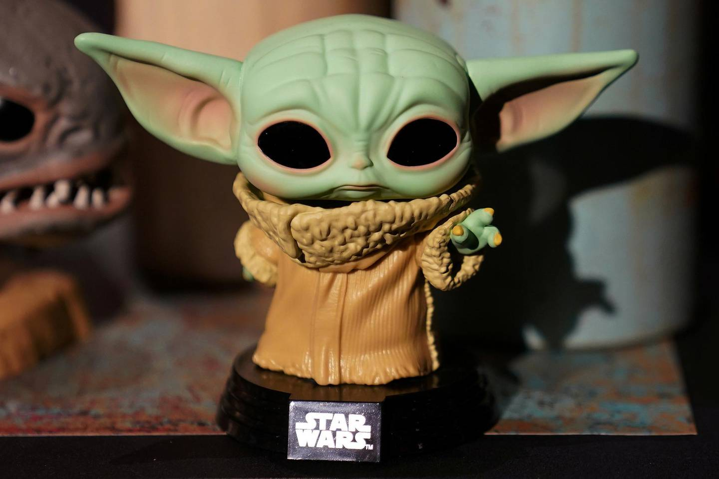 """FILE PHOTO: A Baby Yoda toy is pictured during a """"Star Wars"""" advance product showcase in the Manhattan borough of New York City, New York, U.S., February 20, 2020. REUTERS/Carlo Allegri/File Photo"""