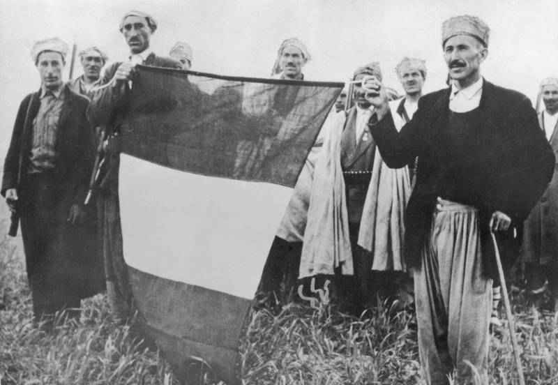 French troops with a recaptured tricolour during the Algerian War of Independence, 1956. (Photo by Keystone/Hulton Archive/Getty Images)