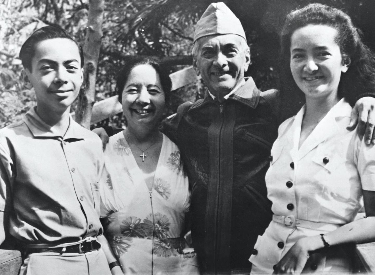 First president of the Philippines Manuel Quezon stands with his son, Manuel Jr., his wife, Dona, and his daughter, Maria. (Photo by © Hulton-Deutsch Collection/CORBIS/Corbis via Getty Images)