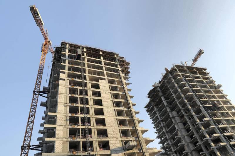 Dubai, United Arab Emirates - December 10, 2018: Construction takes place at the Dubai Creek canal. Neighbourhood profile of Business Bay. Monday the 10th of December 2018 at Marasi Drive, Dubai. Chris Whiteoak / The National
