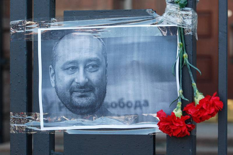 epaselect epa06772534 The Russian opposition journalist Arkady Babchenko portrait is seen on a fence of Russian embassy in Kiev, Ukraine, 30 May 2018. Russian opposition journalist Arkadiy Babchenko, who lived in Ukraine, was shot on 29 May 2018 in his Kiev home by three shots to his back and died from his wounds on the way to hospital, local media report. Babchenko was criticizing Russian authorities and writing about arrests of Crimean-Tatarian journalists in the Crimea after annexation of it by Russia.  EPA/STEPAN FRANKO
