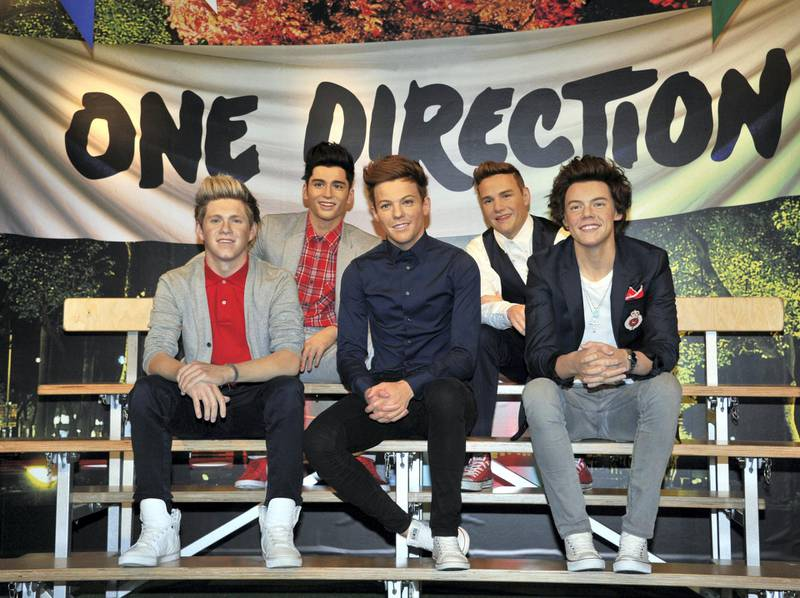 Wax figures of the members of English-Irish boy band 'One Direction' are displayed at the Madame Tussauds museum in Tokyo on February 11, 2014. The wax figures of the pop group will stay in Tokyo until May 12, 2014. AFP PHOTO / Yoshikazu TSUNO (Photo by YOSHIKAZU TSUNO / AFP)
