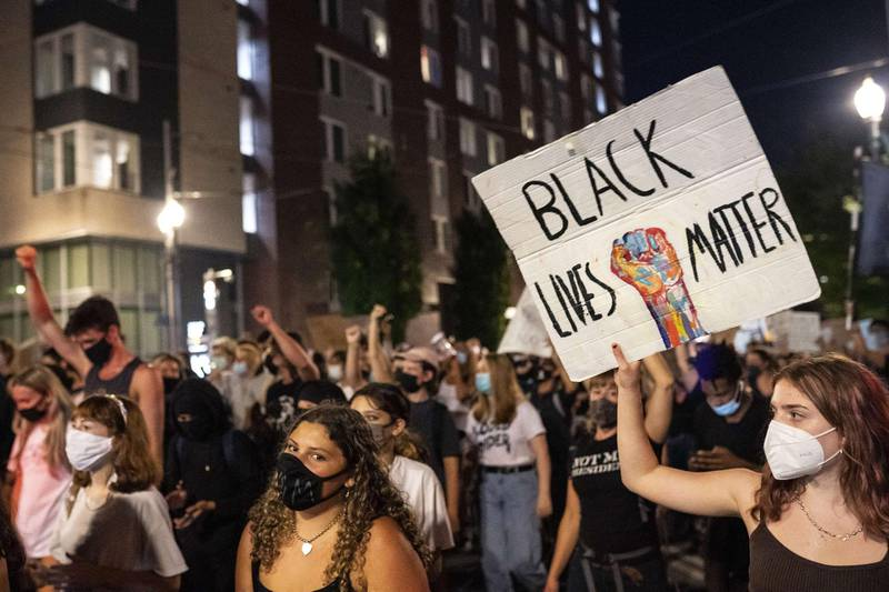 PORTLAND, OR - AUGUST 27: Peaceful protesters march through downtown in solidarity with Jacob Blake on August 27, 2020 in Portland, Oregon. Protests continued across the country Thursday night following the police shooting of Blake in Wisconsin.   Nathan Howard/Getty Images/AFP == FOR NEWSPAPERS, INTERNET, TELCOS & TELEVISION USE ONLY ==