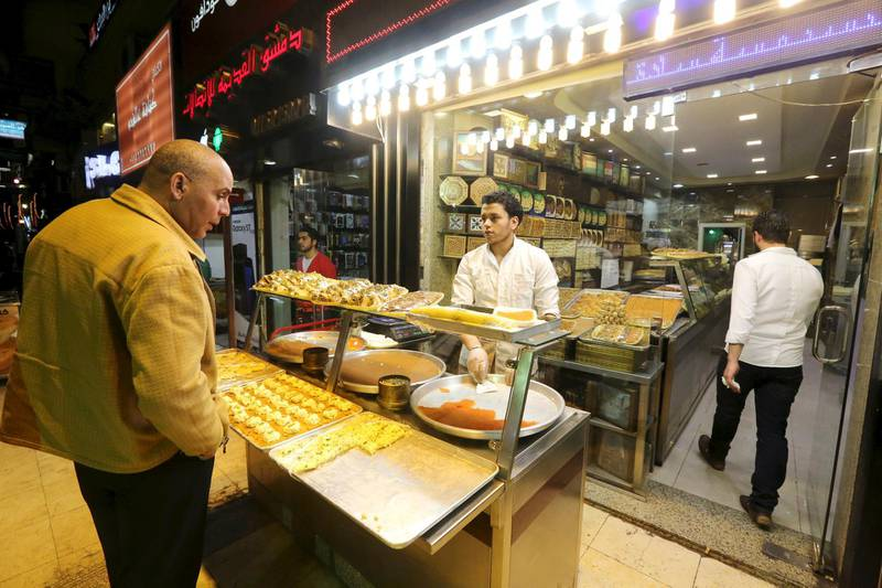 Syrians work at an eastern sweets restaurant in an area called 6 October City in Giza, Egypt, March 19, 2016. Attracting visitors from across the country, a market mostly run by Syrians fleeing the war has recently gained popularity in Giza. The area, in 6 October City, is known as 'Little Damascus' due to its large Syrian population, as well as eateries and shops selling traditional Syrian delicacies.  REUTERS/Mohamed Abd El Ghany