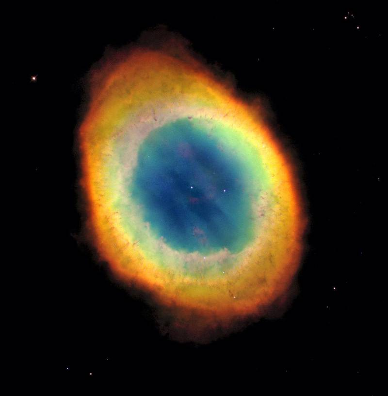 This planetary nebula's simple, graceful appearance is thought to be due to perspective: our view from Earth looking straight into what is actually a barrel-shaped cloud of gas shrugged off by a dying central star. Hot blue gas near the energizing central star gives way to progressively cooler green and yellow gas at greater distances with the coolest red gas along the outer boundary. NASA