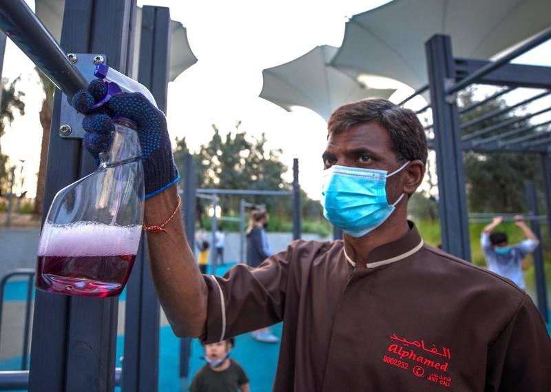 Abu Dhabi, United Arab Emirates, January 21, 2021.  Cleaners are always present around Al Fay Park on Reem Island.Victor Besa/The National Section:  LFReporter: Panna Munyal