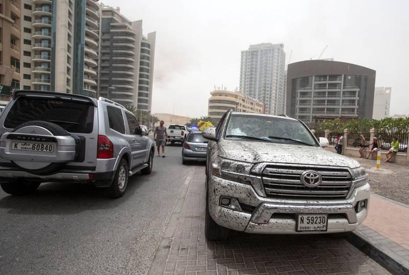 DUBAI, UNITED ARAB EMIRATES 13 MAY 2018 -A car damage  from the  burning Zen Towerin Marina, Dubai. Leslie Pableo for The National