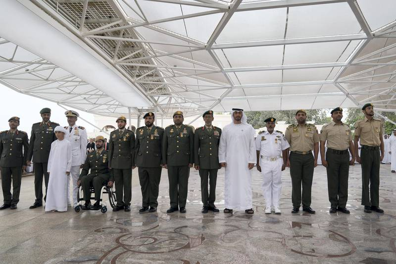 ABU DHABI, UNITED ARAB EMIRATES - April 23, 2018: HH Sheikh Mohamed bin Zayed Al Nahyan Crown Prince of Abu Dhabi Deputy Supreme Commander of the UAE Armed Forces (10th L), stands for a photograph with members of the UAE Armed Forces who served in Yemen, during a Sea Palace barza. Seen with HE Lt General Hamad Thani Al Romaithi, Chief of Staff UAE Armed Forces (9th L), HH Sheikh Zayed bin Hamdan bin Zayed Al Nahyan (5th L), HH Sheikh Saeed bin Hamdan bin Mohamed Al Nahyan, (4th L) HH Sheikh Rashid bin Hamdan bin Zayed Al Nahyan (3rd L) and HE Brigadier General Saleh Mohamed Saleh Al Ameri, Commander of the UAE Ground Forces (2nd L).    ( Mohamed Al Hammadi / Crown Prince Court - Abu Dhabi ) ---