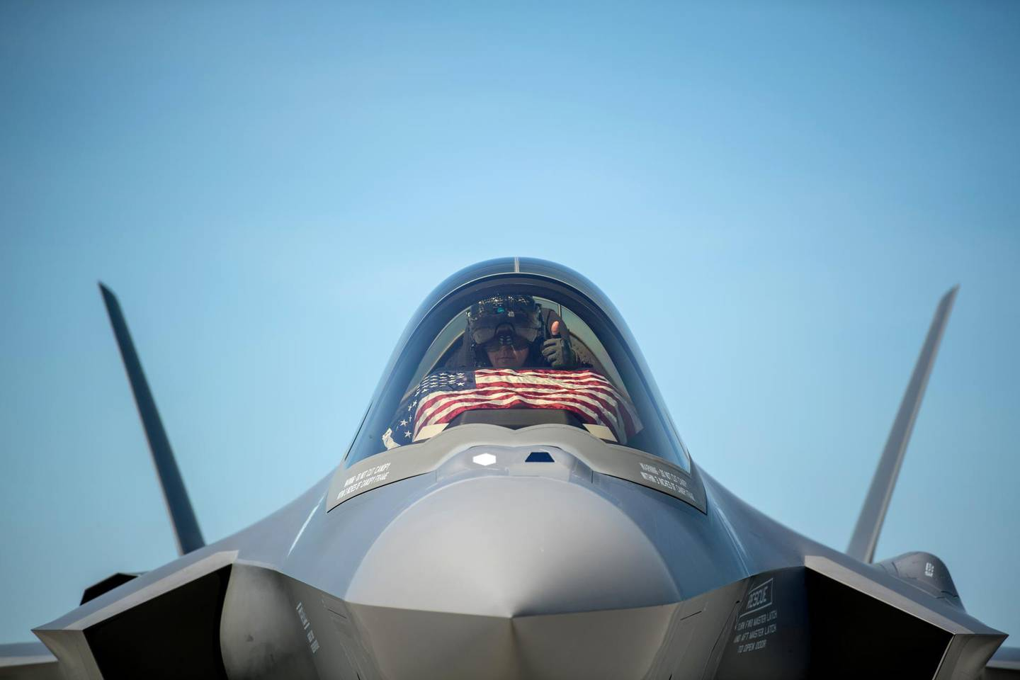 FILE PHOTO: An F-35 pilot prepares for take off from the Vermont Air National Guard Base with the flag of the United States, before a flyover in South Burlington, Vermont, U.S. May 22, 2020. Picture taken May 22, 2020.  U.S. Air National Guard/Miss Julie M. Shea/Handout via REUTERS./File Photo