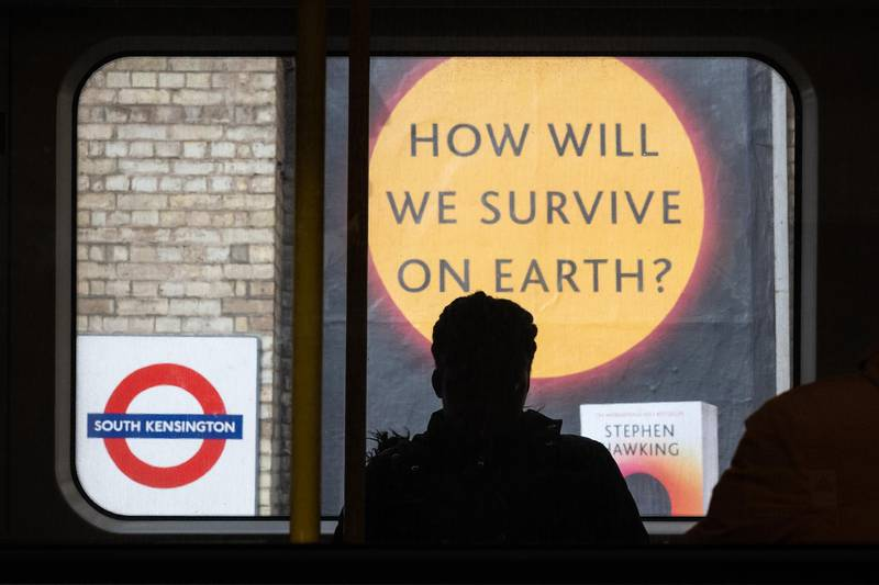 """***BESTPIX*** LONDON, ENGLAND - MARCH 18: A sign advertising a book titled """"How Will We Survive On Earth?"""" is seen on an underground station platform on March 18, 2020 in London, England. Wales and Scotland have today announced that all schools will close from Friday, with England expected to follow. (Photo by Leon Neal/Getty Images)"""