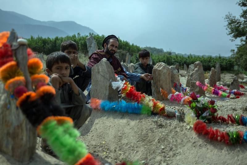 Familes sit by the graves of their relatives, decorated with garlands, and freshly dug just over a week ago. The pain sits deep here in Jawari village, Nangarhar, from where seven people had been killed who were working on the pine nut harvest.