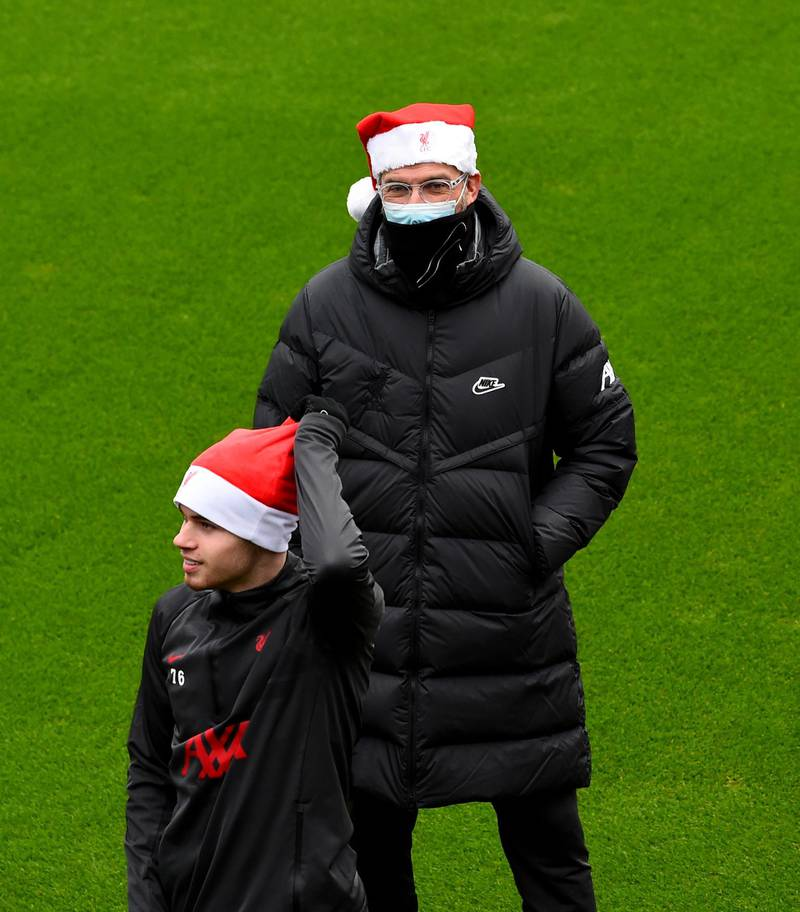 KIRKBY, ENGLAND - DECEMBER 23: (THE SUN OUT, THE SUN ON SUNDAY OUT) Jurgen Klopp manager of Liverpool wearing a Santa hat before a training session at AXA Training Centre on December 23, 2020 in Kirkby, England. (Photo by Andrew Powell/Liverpool FC via Getty Images)