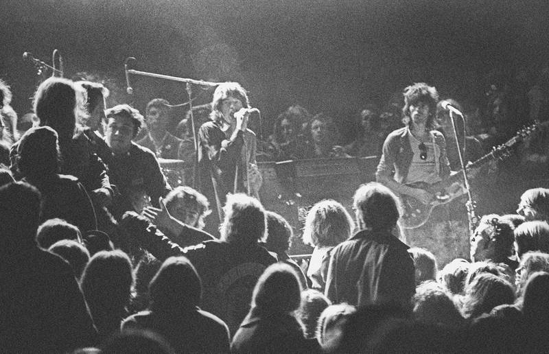LIVERMORE, CA - DECEMBER 6: Mick Jagger and Keith Richards of the Rolling Stones warily eye the Hells Angels onstage at The Altamont Speedway on December 6, 1969 in Livermore, California. (Photo by Robert Altman/Michael Ochs Archives/Getty Images) *** Local Caption *** Mick Jagger;Keith Richards
