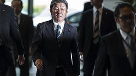 Japan's Shinzo Abe shakes up Cabinet and brings in rising star
