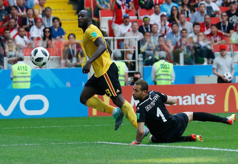Belgium's Romelu Lukaku, left, scores their side's third goal past Tunisia goalkeeper Farouk Ben Mustapha during the group G match between Belgium and Tunisia at the 2018 soccer World Cup in the Spartak Stadium in Moscow, Russia, Saturday, June 23, 2018. (AP Photo/Hassan Ammar)