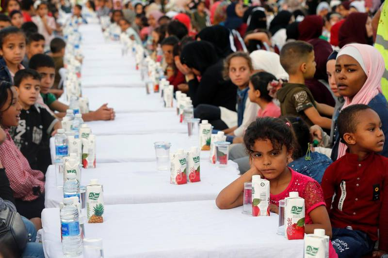 Orphans wait for their iftar meal during Jordan's largest charity event, organised by a society from the UAE for 4,000 children and held at Petra Stadium in Amman, Jordan May 24, 2019. Picture taken May 24, 2019. REUTERS/Muhammad Hamed
