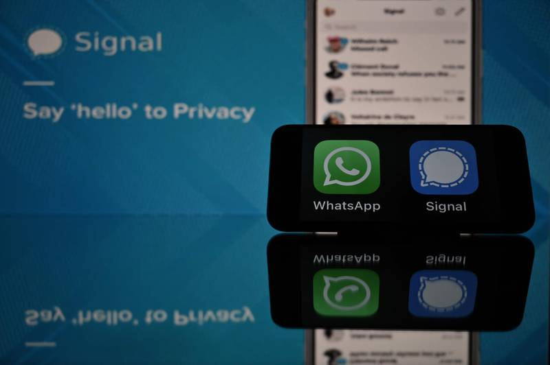 This photograph taken on 11 January, 2021 in Toulouse, southwestern France, shows the logos of WhatsApp and Signal mobile messaging services. Secure messaging app Signal is on the top downloads on Apple Store and Google Play platforms in several countries after the popular messaging app WhatsApp asked its some two billion users on January 7, 2021 to accept new terms that will allow it to share more information with its parents company Facebook and roll out advertising and e-commerce. / AFP / Lionel BONAVENTURE