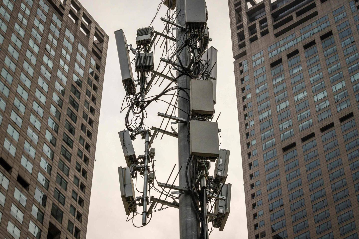 A cellphone tower, used for 5G network, is seen on a street in Beijing on April 7, 2020. / AFP / NICOLAS ASFOURI