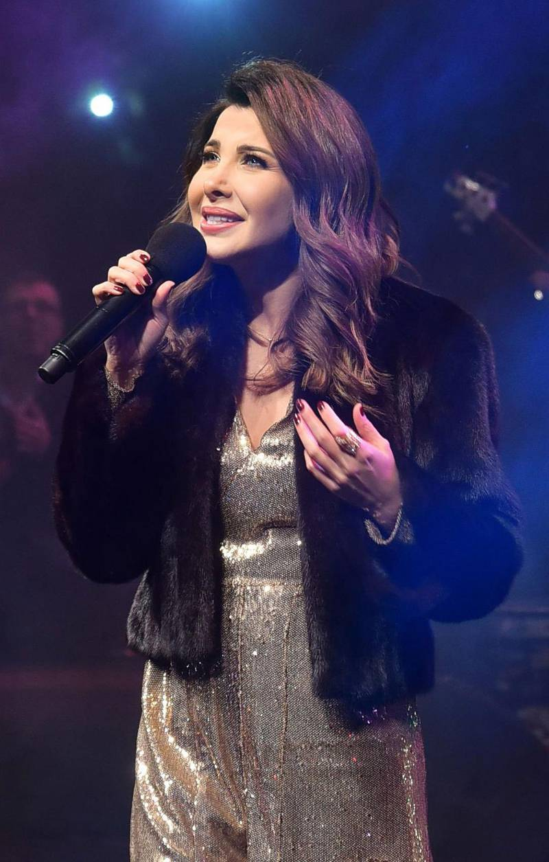 Mandatory Credit: Photo by MAHMOUD AHMED/EPA-EFE/Shutterstock (10505955k)Nancy Ajram performs during the Annual charity concert hosted by the German University in Cairo, Egypt, 14 December 2019 (issued 15 December 2019).Annual charity concert 2019, Cairo, Egypt - 14 Dec 2019