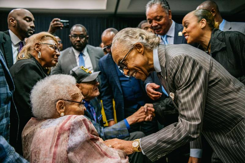 TULSA, OKLAHOMA - JUNE 01: Survivors Hughes Van Ellis and Viola Fletcher are greeted by Rev. Al Sharpton, and Rev. Jesse Jackson at a rally during commemorations of the 100th anniversary of the Tulsa Race Massacre on June 01, 2021 in Tulsa, Oklahoma. President Biden stopped in Tulsa to commemorate the centennial of the Tulsa Race Massacre. May 31st of this year marks the centennial of when a white mob started looting, burning and murdering in Tulsa's Greenwood neighborhood, then known as Black Wall Street, killing up to 300 people and displacing thousands more. Organizations and communities around Tulsa continue to honor and commemorate survivors and community residents.   Brandon Bell/Getty Images/AFP == FOR NEWSPAPERS, INTERNET, TELCOS & TELEVISION USE ONLY ==