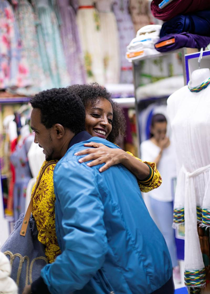 DUBAI, UNITED ARAB EMIRATES. 29 JANUARY 2020. Dina Yassin greets Mulugeta in his shop, Mulugeta Belay Fashion & Ladies Tailoring in Deira.Dina Yassin —a designer— takes us by the hand to explore her favourite spots in Dubai which represent her upbringing as a woman of color, born in Dubai and nurtured by Arab and African culture.In this tour, Street Life app guides the user through Dubai's African Scene, including the oldest and liveliest neighbourhoods, through authentic Ethiopian coffee shops, African fabric stores, the best Ethiopian/Eritrean restaurant and finally, to a night at a dance floor.(Photo: Reem Mohammed/The National)Reporter:Section: