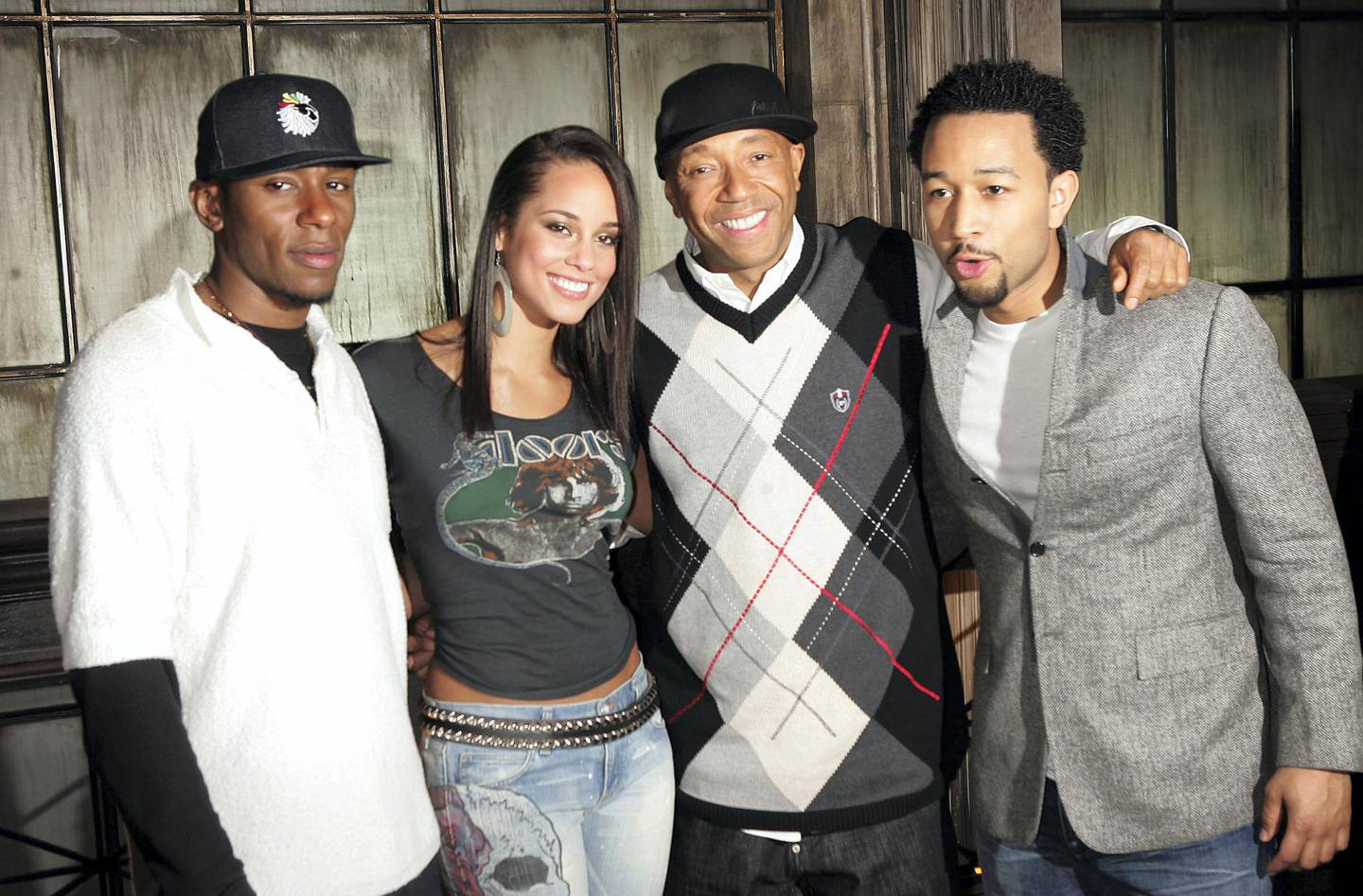 """NEW YORK - FEBRUARY 24: (L-R) Rapper Mos Def, musician Alicia Keys, producer Russell Simmons, and musician John Legend pose for a photo during rehearsals for HBO and Russell Simmons' """"Def Poetry Jam"""" on February 24, 2005 in New York City.  (Photo by Scott Gries/Getty Images)"""