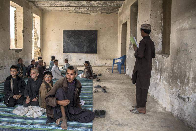 Children sit in a classroom at Shahid Niamatullah Primary School in Panjwayi district, formerly occupied by ISAF and the Afghan National Police.