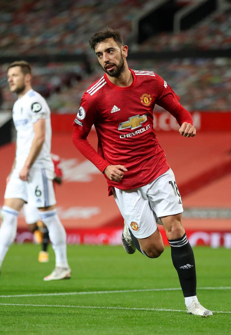 MANCHESTER, ENGLAND - DECEMBER 20: Bruno Fernandes of Manchester United celebrates after scoring their team's third goal  during the Premier League match between Manchester United and Leeds United at Old Trafford on December 20, 2020 in Manchester, England. The match will be played without fans, behind closed doors as a Covid-19 precaution. (Photo by Nick Potts - Pool/Getty Images)