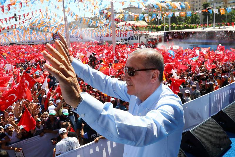 Turkey's President and ruling Justice and Development Party leader Recep Tayyip Erdogan waves as he addresses his supporters during an election rally in Sanliurfa, Turkey, Wednesday, June 20, 2018. 'Turkey holds parliamentary and presidential elections on June 24, 2018, deemed important as it will transform Turkey's governing system to an executive presidency.(Presidential Press Service via AP, Pool)