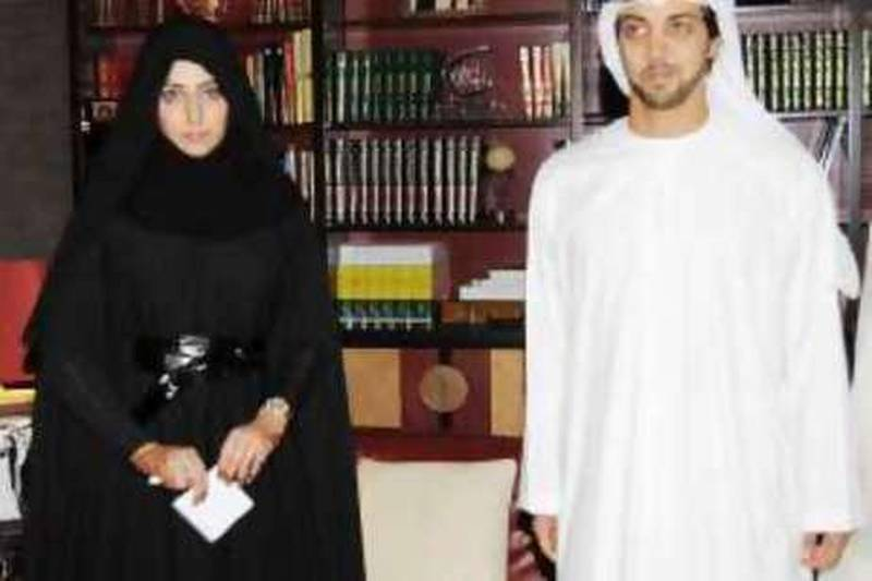 October, 2008-  Khulood Ahmed Jawan Al Dhaheri, First lady judge takes the oath before Mansour bin Zayed WAM  *** Local Caption ***  wam61 07-10-08.jpg