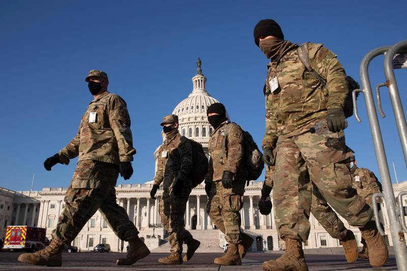 epa08933141 Members of the US National Guard walk on the grounds of the East Front of the US Capitol in Washington, DC, USA, 12 January 2021. At least ten thousand troops of the National Guard will be deployed in Washington by the end of the week, with the possibility of five thousand more, to help secure the Capitol area ahead of more potentially violent unrest in the days leading up to the Inauguration ofUS President-elect Biden. Democrats are attempting to impeach incumbent US President Trump after he incited a mob of his supporters to riot on the US Capitol in an attempt to thwart Congress from certifying Biden's election victory.  EPA/MICHAEL REYNOLDS