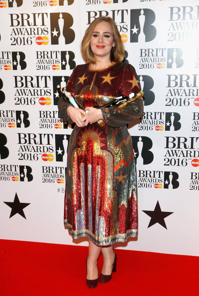 LONDON, ENGLAND - FEBRUARY 24: (EDITORIAL USE ONLY)  Adele poses in the winners room at the BRIT Awards 2016 with her 4 Brit awards at The O2 Arena on February 24, 2016 in London, England.  (Photo by Luca Teuchmann/Getty Images)