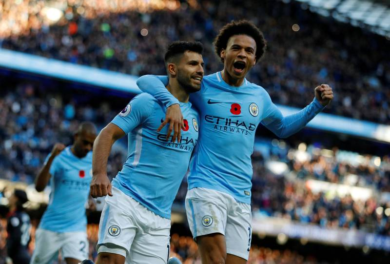 """Soccer Football - Premier League - Manchester City vs Arsenal - Etihad Stadium, Manchester, Britain - November 5, 2017   Manchester City's Sergio Aguero celebrates scoring their second goal with Leroy Sane   REUTERS/Phil Noble  EDITORIAL USE ONLY. No use with unauthorized audio, video, data, fixture lists, club/league logos or """"live"""" services. Online in-match use limited to 75 images, no video emulation. No use in betting, games or single club/league/player publications. Please contact your account representative for further details.     TPX IMAGES OF THE DAY"""
