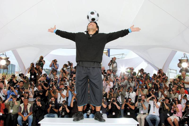 (FILES) In this file picture taken on May 20, 2008 former Argentinian football player Diego Maradona controls the ball as he poses during a photocall for Serbian director Emir Kusturica's film 'Maradona by Kusturica' at the 61st Cannes International Film Festival in Cannes, southern France. Argentine football legend Diego Maradona turns 60 on October 30, 2020.   / AFP / Valery HACHE