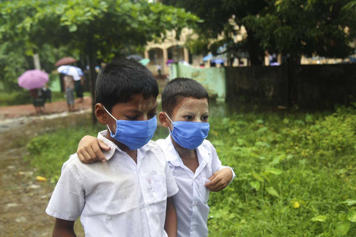 epa09298214 Students wearing face masks leave form Min Gan primary school in Sittwe, Rakhine State, western Myanmar, 24 June 2021. According to a report from the Ministry of Health and Sports, cases of coronavirus disease (COVID-19) are on the rise in Myanmar's Rakhine State.  EPA/STRINGER