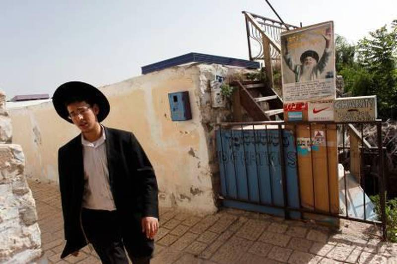 An ultra-Orthodox Jew walks through an alley way in the northern town of Safed May 26, 2010. Safed -- also known as Tzfat -- is where the tourism boom Israel is enjoying with a lull in violence comes with a spiritual twist, thanks in part to the interest the Queen of Pop takes in Jewish Kabbalah mysticism, which has roots in the town. To match Reuters Life! TOURISM-ISRAEL/KABBALAH.   REUTERS/Nir Elias (ISRAEL - Tags: TRAVEL SOCIETY)