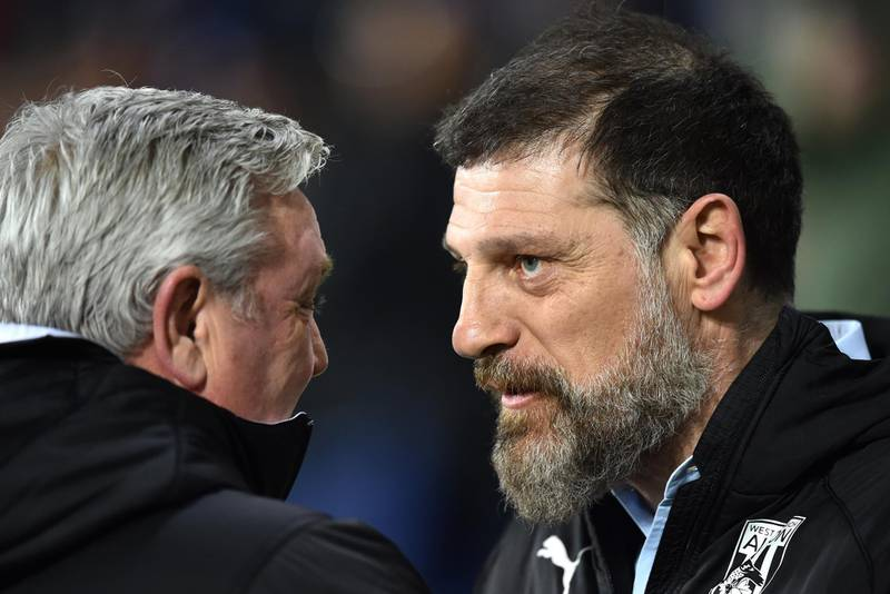 WEST BROMWICH, ENGLAND - MARCH 03: Steve Bruce, Manager of Newcastle United and shake hands with Slaven Bilic, Manager of West Bromwich Albion during the FA Cup Fifth Round match between West Bromwich Albion and Newcastle United at The Hawthorns on March 03, 2020 in West Bromwich, England. (Photo by Nathan Stirk/Getty Images)