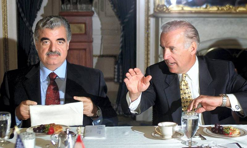 Lebanese Prime Minister Rafiq Hariri (L) attends a meeting with Sen. Joe Biden, (D-DE), and other members of the US Senate Foreign Relations Committee 17 April 2002 at the US Capitol in Washington, DC.     AFP PHOTO / Luke FRAZZA (Photo by LUKE FRAZZA / AFP)