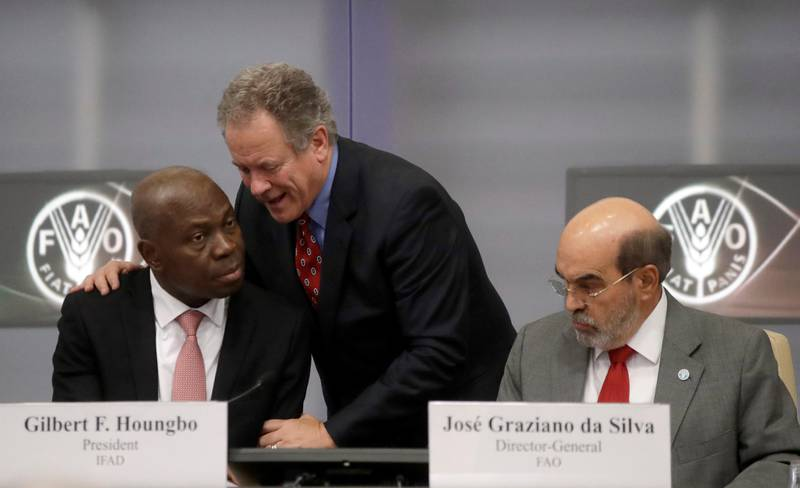 United Nations World Food Program Executive-Director David Beasly, center, shares a word with IFAD President Gilbert F. Houngbo, left, and Director-General of the United Nations Food and Agriculture Organization (FAO) Jose' Graziano da Silva,  at the FAO headquarters, in Rome, Friday, Sept. 15, 2017.  The number of chronically hungry people in the world is on the rise again after a decade of declines, the United Nations reported Friday, citing intensifying conflicts, floods and droughts. (AP Photo/Alessandra Tarantino)