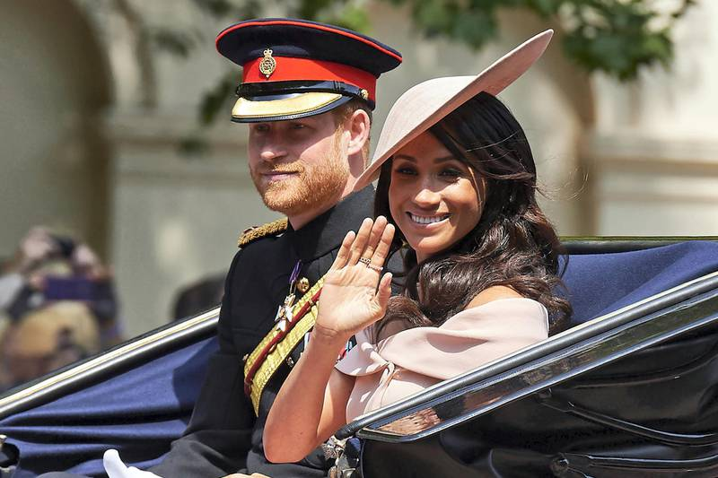 Britain's Prince Harry, Duke of Sussex and Britain's Meghan, Duchess of Sussex return in a horse-drawn carriage after attending the Queen's Birthday Parade, 'Trooping the Colour' on Horseguards parade in London on June 9, 2018. - The ceremony of Trooping the Colour is believed to have first been performed during the reign of King Charles II. In 1748, it was decided that the parade would be used to mark the official birthday of the Sovereign. More than 600 guardsmen and cavalry make up the parade, a celebration of the Sovereign's official birthday, although the Queen's actual birthday is on 21 April. (Photo by Niklas HALLEN / AFP)